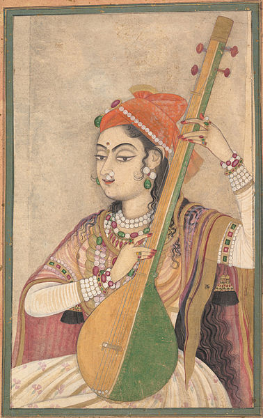 lady playing tanpura